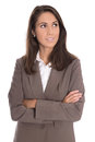 Sceptically isolated business woman in brown blazer looking side