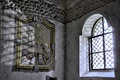 Scheleton painting in italian romanesque church near a window Royalty Free Stock Image