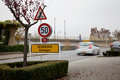 Schengen City Limit Sign and Blurred Passing Car Royalty Free Stock Photo