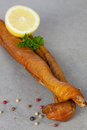 Schiller lure smoked fish with pepper and lemon Stock Photos