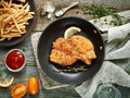 Schnitzel on cooking pan Royalty Free Stock Photo