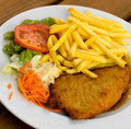 Schnitzel - cutlet with french fries and Salad Royalty Free Stock Images