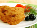 Schnitzel and vegetables on white plate Royalty Free Stock Images