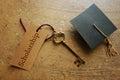 Scholarship key and cap Royalty Free Stock Photo