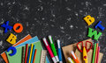 School accessories, stationery on dark background. Top view, free space for text. Royalty Free Stock Photo