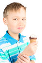 School age boy eating cone ice cream isolated white Royalty Free Stock Photos