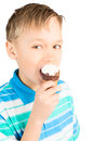 School age boy eating cone ice cream isolated white Stock Photo