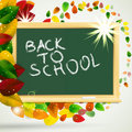 School autumn background with blackboard and leves