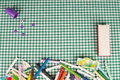 School background assortment of crayons on a green Stock Photo