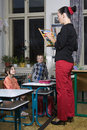 At school with bad teacher children first class Royalty Free Stock Images