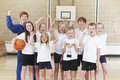 School Basketball Tean And Coach Celebrating Victory With Trophy Royalty Free Stock Photo