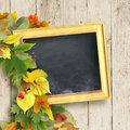 school board and a bouquet of autumn leaves on wooden background