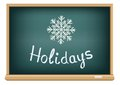 School board holidays text message on the blackboard that represent the winter Stock Photos