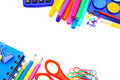 School border colorful of supplies over a white background Stock Photography