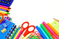 School border colorful of supplies over a white background Royalty Free Stock Image