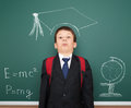 School boy with academic cap painted on board Stock Image
