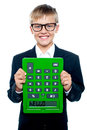 School boy holding calculator upside down Stock Photography