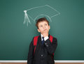 School boy portrait with academic cap Royalty Free Stock Photo