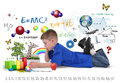 School boy reading education book on white a young is a with math formulas art icons and nature objects around the child for an Stock Image