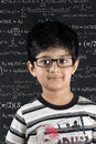 School boy standing in class near a blackboard Stock Photography