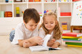 School boy teaching her sister how to read Royalty Free Stock Photo
