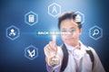 School boy touching Back to school button using Virtual Screen Hologram Royalty Free Stock Photo
