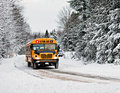 School Bus Driving Down A Snow Covered Rural Road - 2 Royalty Free Stock Photo