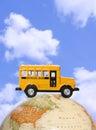School Bus on Globe Royalty Free Stock Photo