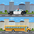 School bus and police car in urban landscape