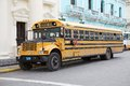 School bus typical old classic north amrican parked along the street in santa clara cuba Stock Photo