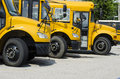 School busses Lined up to Transport kids Royalty Free Stock Photo