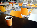 School cafeteria table with cup of tea Royalty Free Stock Photography