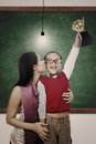 School champion holding trophy kiss by mum in class preschooler a a classroom while his is kissing him Royalty Free Stock Image