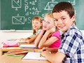 School child sitting in classroom. Royalty Free Stock Images