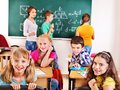 School child with teacher in classroom Royalty Free Stock Photos