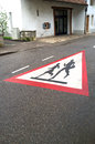 School children crossing road sign paint on a Royalty Free Stock Image