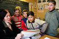 School children gathered around a schoolteacher tver russia may class in the russian village teacher communicates with students Royalty Free Stock Photo