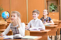School children at lesson in classroom Stock Photography