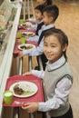 School children standing in line in school cafeteria Royalty Free Stock Images