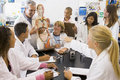 School children and their teacher in science class Royalty Free Stock Photo