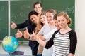 School class teacher motivating students Royalty Free Stock Photo