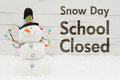 School Closed message with a snowman