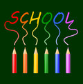 School colored pencils writing word on green background Royalty Free Stock Photos
