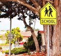 School crossing ahead yellow sign Stock Photography