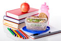 School essentials including books pencils a drink and snacks Royalty Free Stock Photography