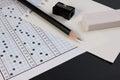 School exam answer sheet and pen. Standard test form or answer sheet. Answer sheet focus on pencil.