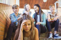 School friends bullying a sad girl in school corridor Royalty Free Stock Photo