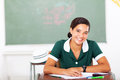 School girl classroom portrait of cheerful high sitting in Stock Image