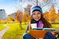 School girl with coffee and textbook close portrait of nice happy smiling years old holding mug wearing blue purple hat scurf Stock Images