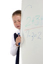 School girl cries standing near a board Stock Photos